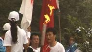 Olympische Flamme verschwindet im Dunst