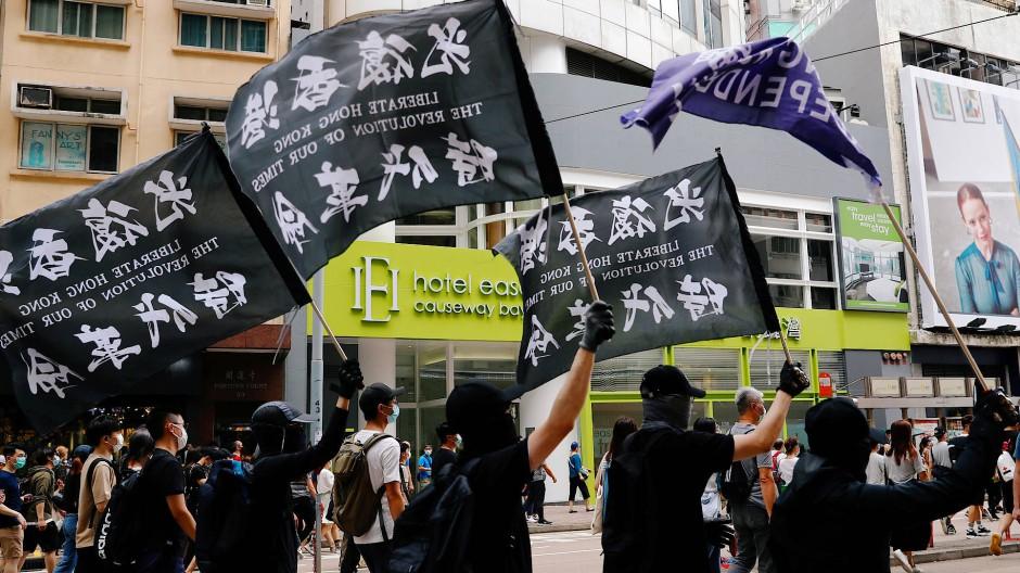 In Hongkong wird protestiert, die deutschen Unternehmen äußern sich aber kaum zu den Menschenrechtsverstößen.