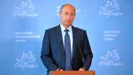 """Russlands Präsident Wladimir Putin in Wladiwostok: """"Die Menschen in Syrien fliehen nicht vor dem Regime Assad, sondern vor dem IS."""""""