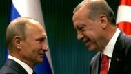Auf goldene Zeiten: Putin und Erdogan investieren in das Edelmetall.