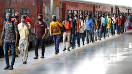 Indiens Wanderarbeiter kehren an den Arbeitsplatz zurück