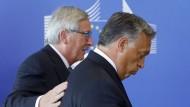 """""""Umgestaltung zu einem Migrationsland"""": Juncker und Orbán im Jahr 2015"""