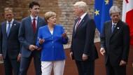 Eine Partnerschaft in der Krise: Angela Merkel und Donald Trump in Taormina (Mitte)