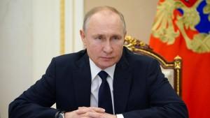 Merkel ruft Putin zu Abbau russischer Truppen auf
