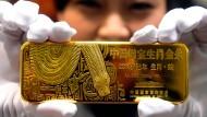 """Teures Erinnerungsstück: Goldbarren zum """"Jahr der Schlange"""", das China im Jahr 2013 beging"""