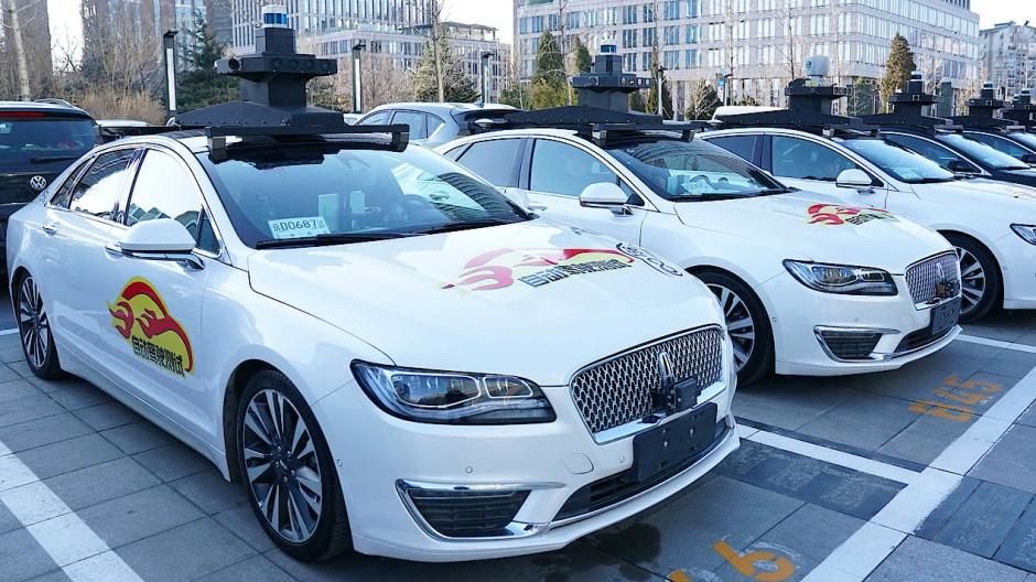 Flottenbewegung: Das autonome Fahren wird überall in der Welt erprobt, dieses Bild entstand in Peking. Aber der Fortschritt ist langsamer als vielfach versprochen.