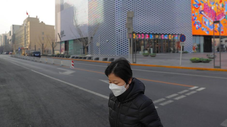 Keine Party, stattdessen leere Straßen wie hier in Peking am Samstag in Peking:  Um Ansteckungen zu verhindern, hat China Feiern zum Neujahrsfest abgesagt.