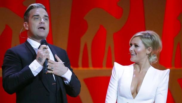 Robbie Williams singt mit Helene Fischer