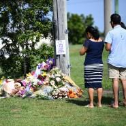 In ihrer Heimatstadt Nahe Brisbane trauern Menschen um die getötete Frau und ihre drei Kinder.