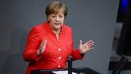Merkel verteidigt Asyl-Kompromiss