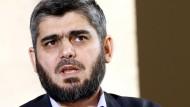 Muhammad Alloush bekundet bei den Gesprächen in Genf den eigenen guten Willen und zeigt mit dem Finger auf die Vertreter des syrischen Machthabers.