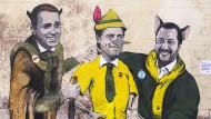 Der italienische Ministerpräsident Giuseppe Conte (Mitte) und seine Stellvertreter Matteo Salvini von der Lega (rechts) und Luigi Di Maio von den Fünf Sternen (links) auf einem Wandbild in Rom.