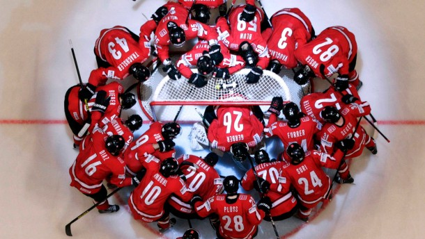 Switzerland's players huddle before their 2013 IIHF Ice Hockey World Championship final match against Sweden at the Globe Arena in Stockholm