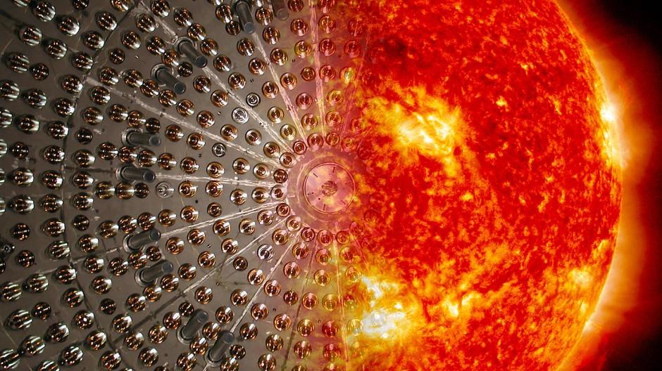 Die Sonne auf die Erde geholt: künstlerische Vereinigung der Stahlkuppel des Borexino-Detektors und unseres Heimatsterns