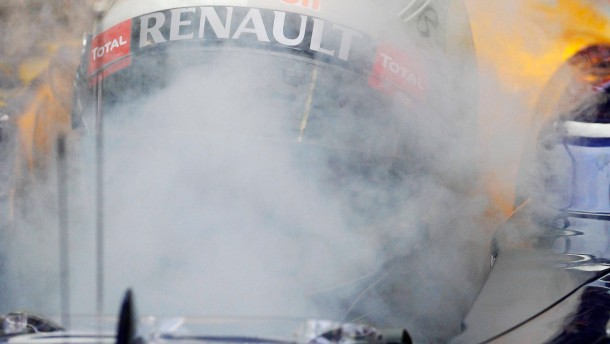 Red Bull Formula One driver Vettel of Germany cools off with dry ice during the third practice session of the Italian F1 Grand Prix at the Monza circuit