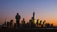 Die New Yorker Banker freuen sich über die steigenden Zinsen.