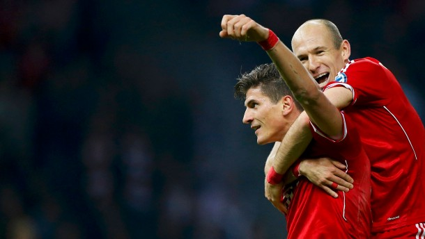 Bayern Munich's Gomez celebrates with team mate Robben after scoring a goal against VfB Stuttgart during their German soccer cup (DFB Pokal) final match at the Olympic Stadium in Berlin