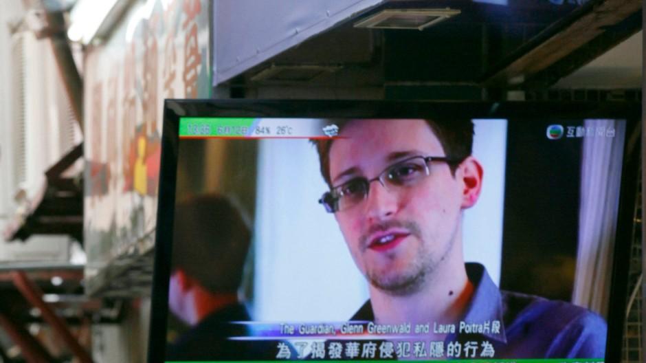 Held oder Verräter? Snowden, hier auf einem Fernsehschirm in Hongkong