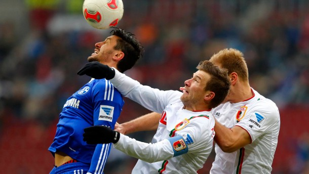 Augsburg's Klavan and Baier challenge Marica of Schalke 04 during their German Bundesliga first division soccer match in Augsburg