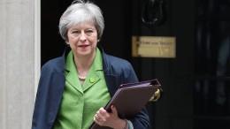 May entgeht der Pleite im Parlament