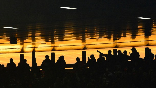 Fans watch Arsenal play Stoke City during their English Premier League soccer match at Emirates Stadium in London