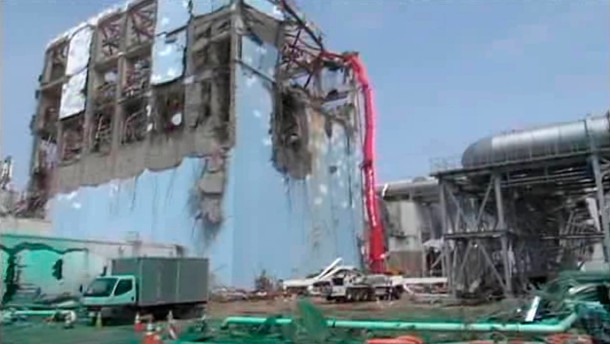 FIle photo of a concrete pumping vehicle spraying water to the spent fuel pool of No.4 reactor at TEPCO's Fukushima Daiichi Nuclear Power Station