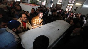 Mourners carry the bodies of victims of Wednesday's soccer violence during their funeral in Port Said