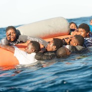 Migrants waiting to be rescued by a ship run by SOS Mediterranee in the Mediterranean Sea off the Libyan coast