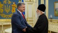 Der ukrainische Präsident Petro Poroschenko und Patriarch Filaret