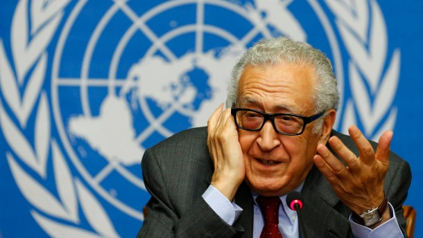 Arab League-United Nations envoy Brahimi gestures during a news conference on the situation in Syria at the UN in Geneva