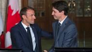 Macron und Trudeau behaupten freiheitliche Werte