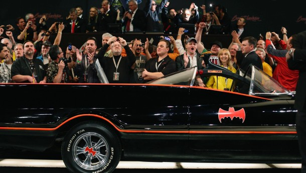 Spectators cheer as the original Batmobile is sold for $4,200,000 during the Barrett-Jackson collectors car auction in Scottsdale, Arizona