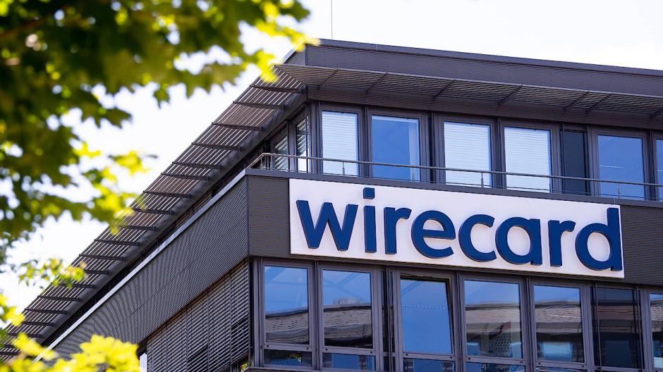 Der Schriftzug von Wirecard an der Firmenzentrale des insolventen Zahlungsdienstleisters