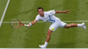 Philipp Kohlschreiber of Germany hits a return to Ivan Dodig of Croatia in their men's singles tennis match at the Wimbledon Tennis Championships, in London