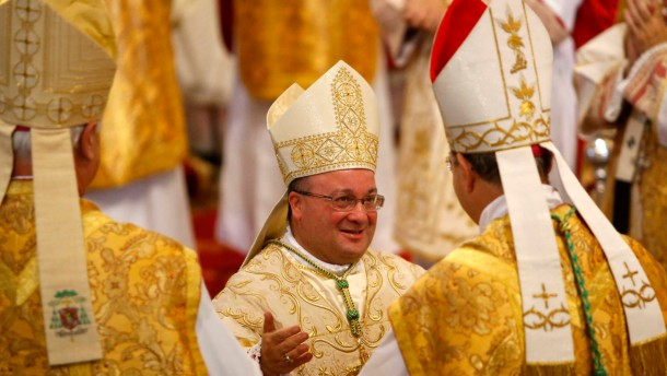 Newly-ordained Auxiliary Bishop of Malta Monsignor Scicluna is congratulated by fellow bishops during his ordination ceremony at St John's Co-Cathedral in Valletta