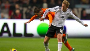 Afellay of the Netherlands fights for ball with Holtby of Germany during  friendly soccer match in Amsterdam