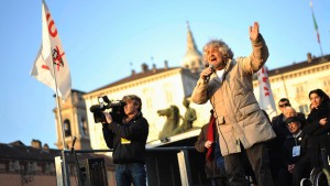 Five-Star Movement leader and comedian Grillo gestures during a rally in Turin