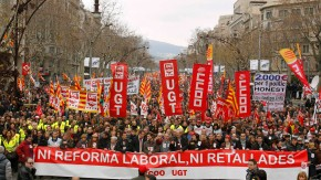 People protest against labour reforms imposed by the Spanish government in central Barcelona