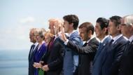 Als Trump noch da war, schien alles okay – doch nach seiner Abreise beschimpfte er Ministerpräsident Trudeau (Mitte).