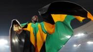 Auch aus Jamaika: Usain Bolt nach seinem Olympiasieg über 200 Meter 2008 in Peking.