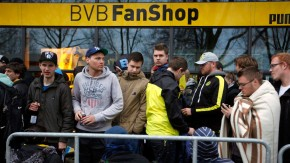 Supporters of Borussia Dortmund queue for tickets at a ticket agency of Borussia Dortmund in Dortmund