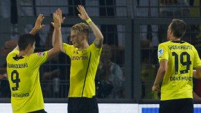 Borussia Dortmund's Lewandowski and Reus celebrate a goal against Werder Bremen during the German first division Bundesliga soccer match in Dortmund