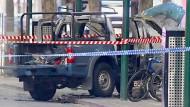 Der ausgebrannte Wagen in der Melbourner Innenstadt.