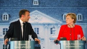 Macron unterstützt Merkel in der Asylpolitik