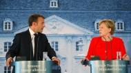 Der französische Präsident Macron und Kanzlerin Merkel bei einer gemeinsamen Pressekonferenz am Dienstag.