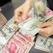 US-Dollar und Renminbi: Ihr Wechselkurs-Verhältnis bestimmt den Welthandel mit.
