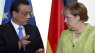 Will weiter gegen die Erderwärmung kämpfen: der chinesische Ministerpräsident Li Keqiang am Donnerstag mit Kanzlerin Merkel in Berlin