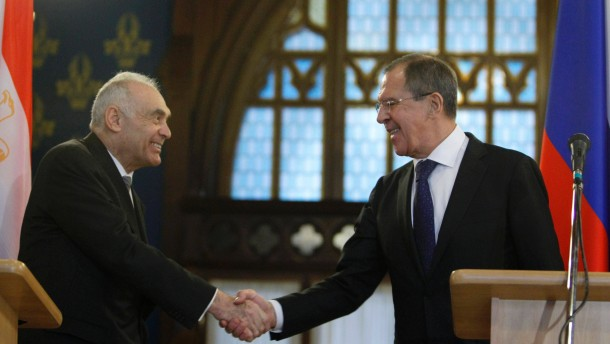 Russia's Foreign Minister Lavrov shakes hands with his Egyptian counterpart Kamel Amr in Moscow