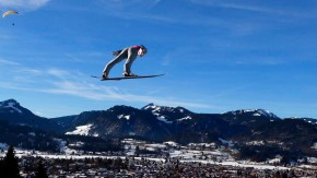 Germany's Schmitt soars through the air during the practice for the first jumping of the 61st four-hills ski jumping tournament in Oberstdorf