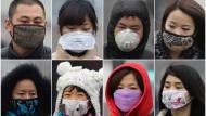 Die Gesichtsmasken sind ein kleiner Schutz gegen die schlechte Luft